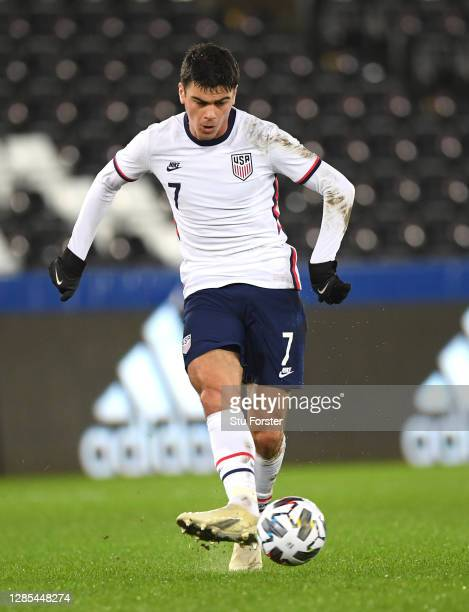 Player Giovanni Reyna in action during the international friendly match between Wales and the USA at Liberty Stadium on November 12, 2020 in Swansea,...