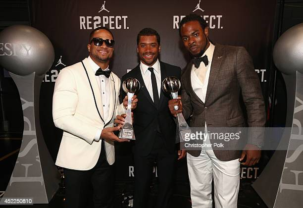 NFL player Golden Tate Russell Wilson and Richard Sherman accepting award for Best Team at The 2014 ESPYS at Nokia Theatre LA Live on July 16 2014 in...