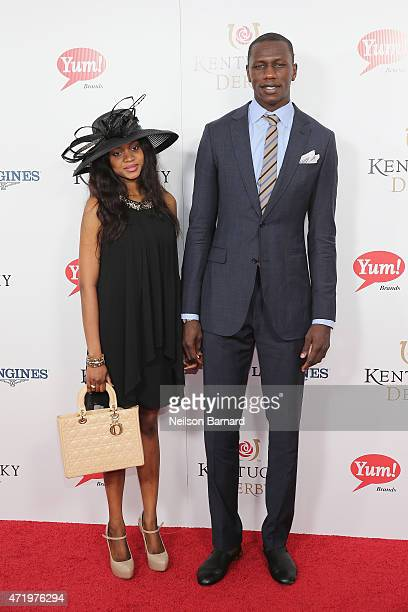 NBA player Gorgui Dieng and a guest attend the 141st Kentucky Derby at Churchill Downs on May 2 2015 in Louisville Kentucky