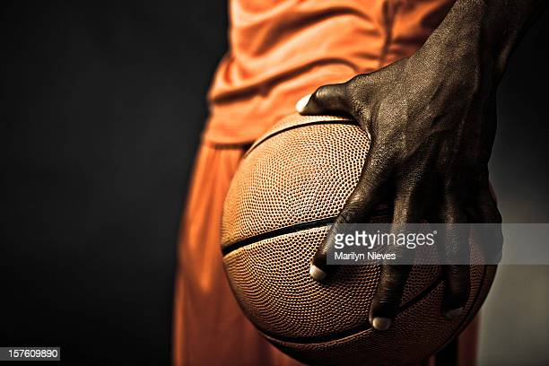player gripping the basketball
