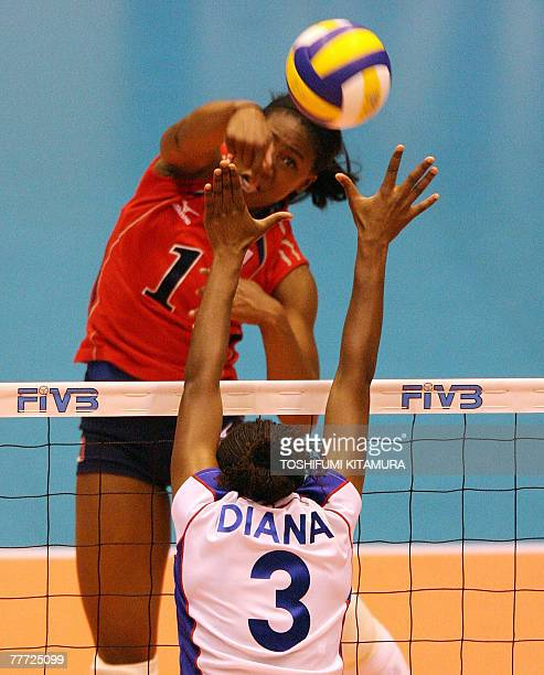 US player Heather BownOgonna Nnamani spikes the ball above Kenya's Diana Khisa during their FIVB Women's World Cup second round match in Sendai 06...