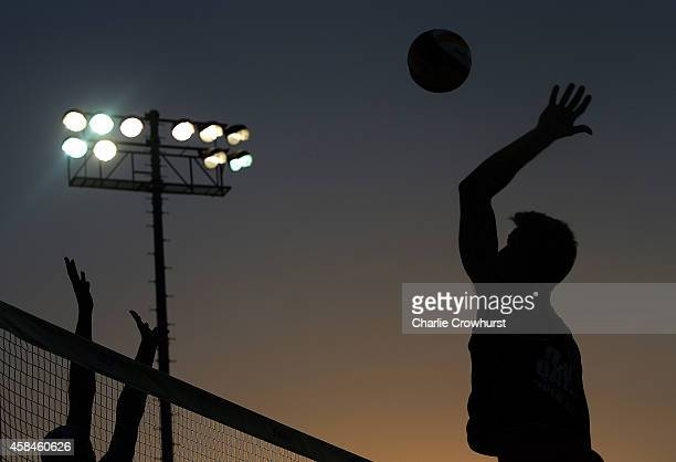 Player hits a spike shot as the sun sets during day two of the FIVB Qatar Open at The Al Gharafa Sports Club on November 05, 2014 in Doha, Qatar.
