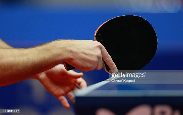 A player holds a racket during the LIEBHERR table tennis team world cup 2012 championship division group B men's team match between Germany and Czech...