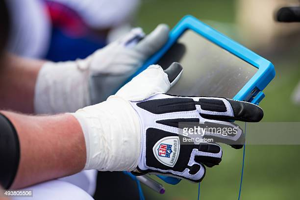 A player interacts with a Microsoft Surface tablet during the game between the Buffalo Bills and the New York Giants on October 4 2015 at Ralph...