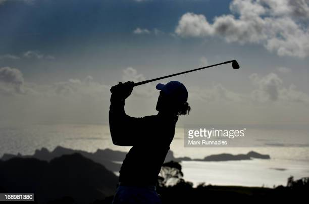 A player is silhouetted as he warms up on the practice range in the warm morning sun during Day Three of Madeira Islands Open Portugal BPI at Club de...
