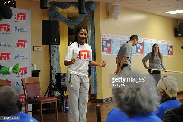 WNBA player Ivory Latta of the Washington Mystics and Kaiser Permanente partner with WNBA Fit Clinic to work out at The Frank Bailey Senior Center in...