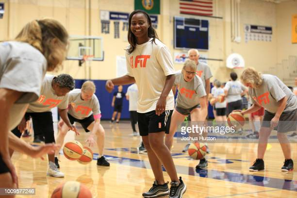 WNBA player Ivory Latta works on dribbling drill with participants of the WNBA Fit Clinic on JULY 21 2018 at Olympia High School Olympia Washington...