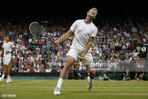 US player Jack Sock reacts to losing a point as teammate Canada's Vasek Pospisil looks on against US players Bob and Mike Bryan during their men's...