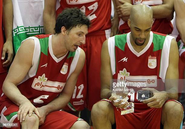 US player Jackson Vroman of Iran's Mahram club speaks with his teammate and countryman Loren Woods following their Dubai International Basketball...