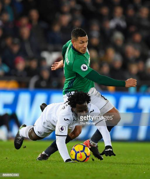 WBA player Jake Livermore challenges Wilfried Bony of Swansea during the Premier League match between Swansea City and West Bromwich Albion at...