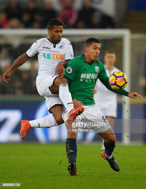 WBA player Jake Livermore is challenged by Wayne Routledge of Swansea during the Premier League match between Swansea City and West Bromwich Albion...