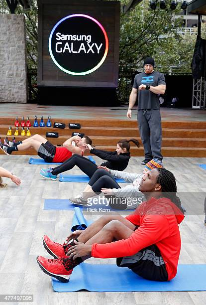 NFL player Jamaal Charles works out during crossfit at The Samsung Galaxy Experience at SXSW 2014 on March 9 2014 in Austin Texas