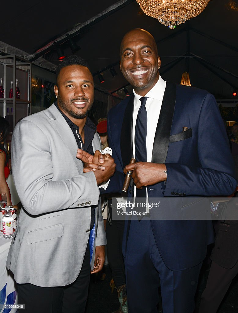 NFL player James Anderson (L) and former NBA player John Salley at R.E.S.T.O.R.E: The Foundation For Reconstructive Surgery Charity Event on March 19, 2016 in Los Angeles, California.