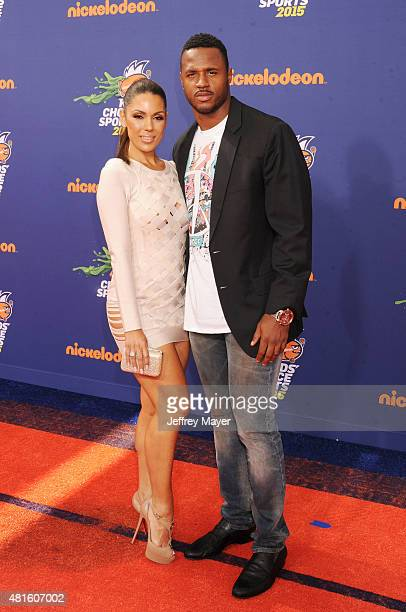 NFL player James Anderson and model Carissa Rosario arrive at the Nickelodeon Kids' Choice Sports Awards 2015 at UCLA's Pauley Pavilion on July 16...