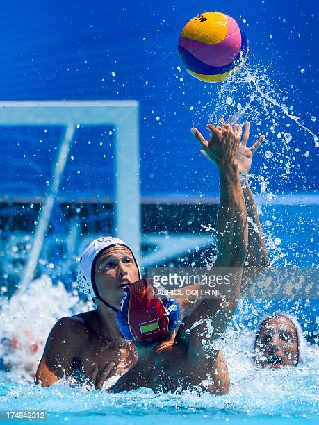 US player Janson Wigo vies with Spains' Albert Espanol during their men's water polo quarterfinals qualification match at the FINA World...
