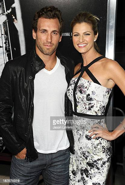 NHL player Jarret Stoll and sportscaster Erin Andrews attend the premiere of Captain Phillips at the Academy of Motion Picture Arts and Sciences on...