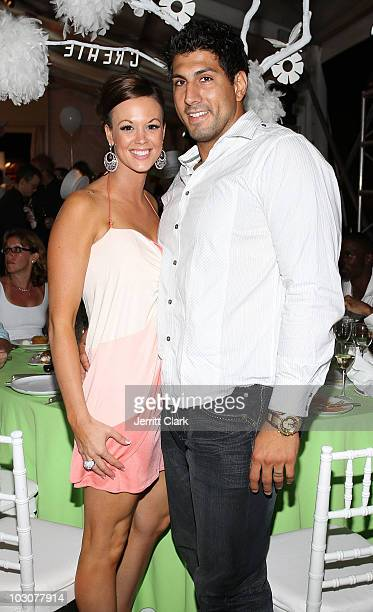 Player Jason Babin and wife Sara attend the Art For Life East Hampton 11th Annual Benefit at Russell Simmons' East Hampton Estate on July 24 2010 in...