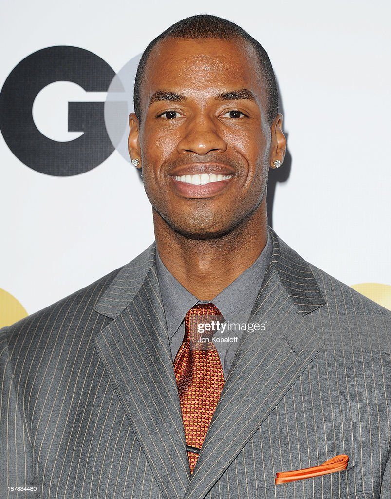 NBA player Jason Collins arrives at GQ Celebrates The 2013 'Men Of The Year' at The Wilshire Ebell Theatre on November 12, 2013 in Los Angeles, California.
