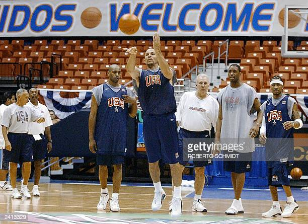 US player Jason Kidd gets the attention of his teammates Allen Iverson Ray Allen Vince Carter and assistant coach Gregg Popovich as he shoots a long...