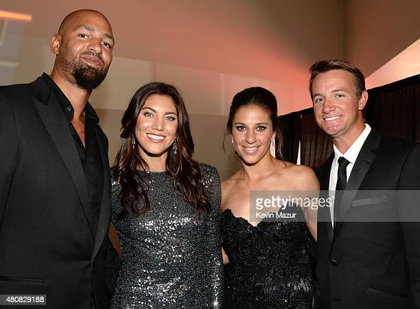 Player Jerramy Stevens with USWNT soccer players Hope Solo and Carli Lloyd and husband Brian Hollins attend The 2015 ESPYS at Microsoft Theater on...