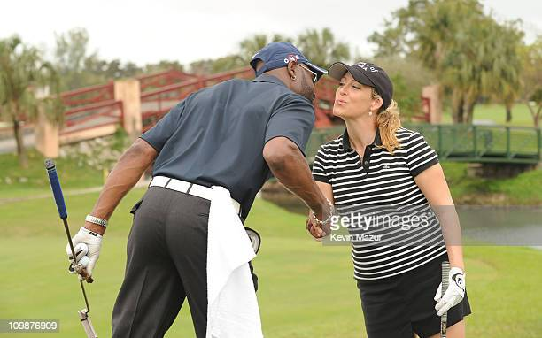 NFL Player Jerry Rice and LPGA Player Christie Kerr attend the Super Skins Celebrity Golf Classic Tee Off at The Biltmore Hotel Golf Club on February...