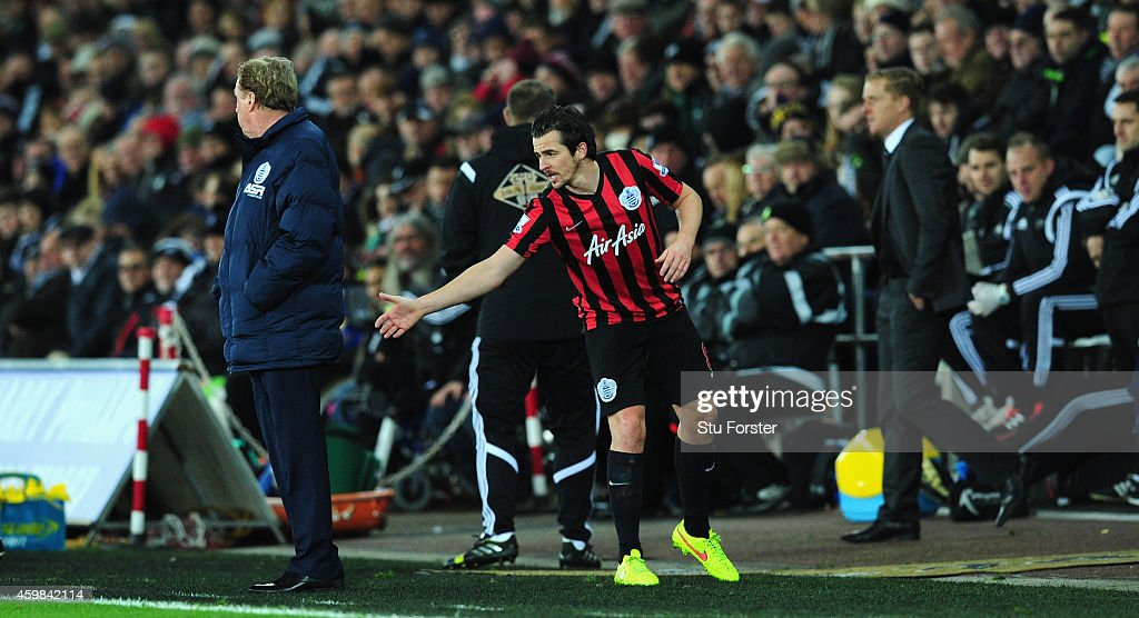QPR player Joey Barton attempts to shake hands with manager Harry Redknapp during the Barclays Premier League match between Swansea City and Queens Park Rangers at Liberty Stadium on December 2, 2014 in Swansea, Wales.