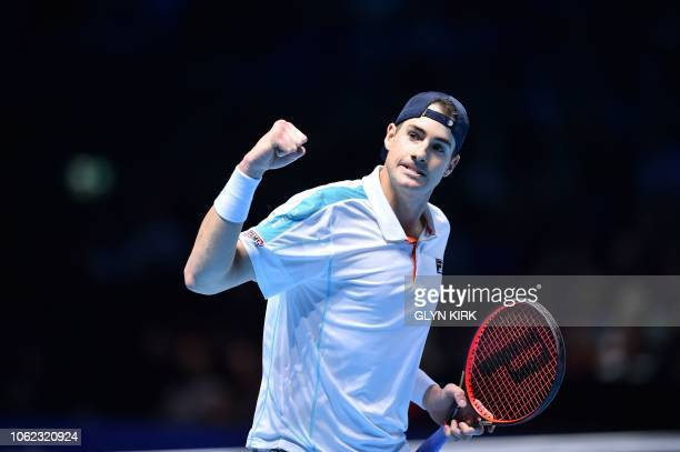 US player John Isner celebrates after a point against Germany's Alexander Zverev in their men's singles roundrobin match on day six of the ATP World...