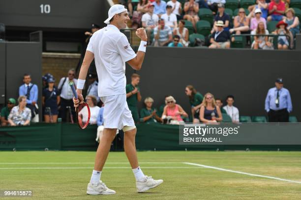 US player John Isner celebrates after beating Greece's Stefanos Tsitsipas 64 76 76 in their men's singles fourth round match on the seventh day of...