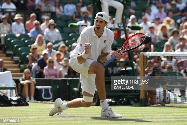 US player John Isner celebrates winning a point against South Africa's Kevin Anderson during their men's singles semifinal match on the eleventh day...