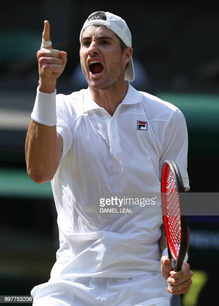 US player John Isner celebrates winning the second set against South Africa's Kevin Anderson during their men's singles semifinal match on the...