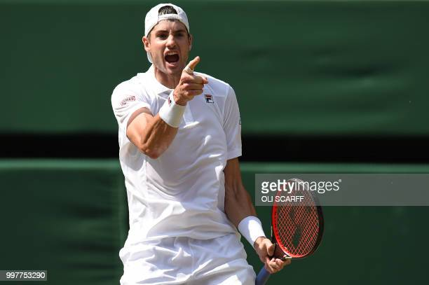 TOPSHOT US player John Isner celebrates winning the second set against South Africa's Kevin Anderson during their men's singles semifinal match on...