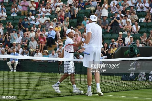 US player John Isner greets Moldova's Radu Albot after winning 63 63 64 in their men's singles third round match on the fifth day of the 2018...