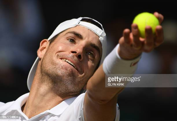 US player John Isner prepares to serve against South Africa's Kevin Anderson during their men's singles semifinal match on the eleventh day of the...