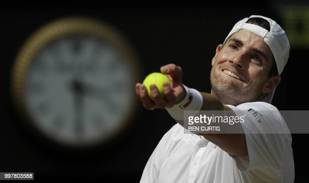 Player John Isner prepares to serve against South Africa's Kevin Anderson during their men's singles semi-final match on the eleventh day of the 2018...
