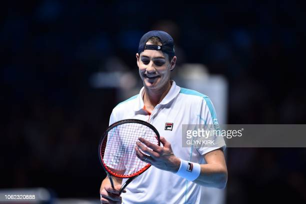 US player John Isner reacts after a point against Germany's Alexander Zverev in their men's singles roundrobin match on day six of the ATP World Tour...
