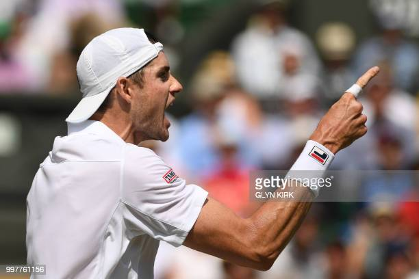 US player John Isner reacts against South Africa's Kevin Anderson during their men's singles semifinal match on the eleventh day of the 2018...