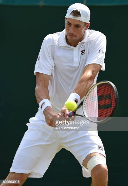 US player John Isner returns against Israel's Dudi Sela during their men's singles second round match on the fourth day of the 2017 Wimbledon...