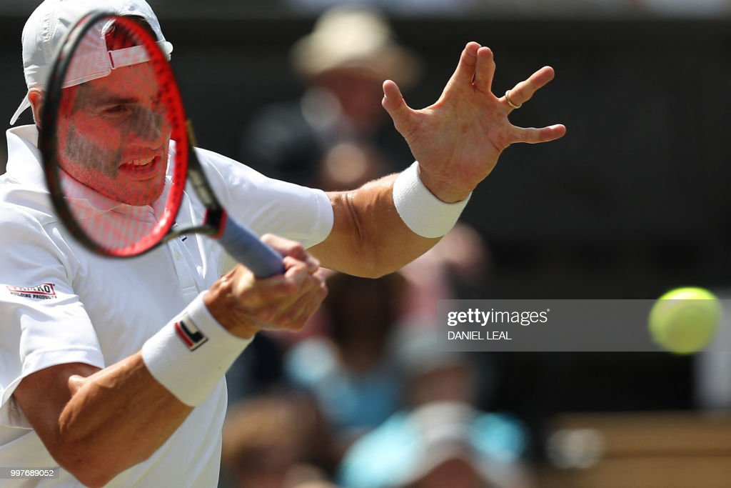 US player John Isner returns against South Africa's Kevin Anderson during their men's singles semi-final match on the eleventh day of the 2018 Wimbledon Championships at The All England Lawn Tennis Club in Wimbledon, southwest London, on July 13, 2018. (Photo by Daniel LEAL-OLIVAS / AFP) / RESTRICTED