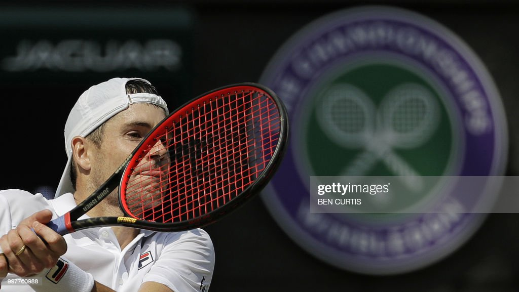 US player John Isner returns against South Africa's Kevin Anderson during their men's singles semi-final match on the eleventh day of the 2018 Wimbledon Championships at The All England Lawn Tennis Club in Wimbledon, southwest London, on July 13, 2018. (Photo by Ben Curtis / POOL / AFP) / RESTRICTED