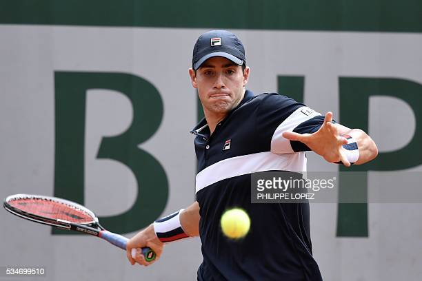 US player John Isner returns the ball to Russia's Teimuraz Gabashvili during their men's third round match at the Roland Garros 2016 French Tennis...