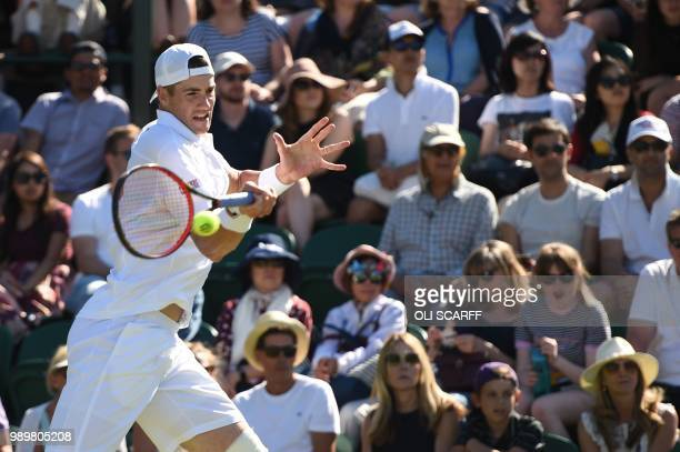 US player John Isner returns to Germany's Yannick Maden during their men's singles first round match on the first day of the 2018 Wimbledon...