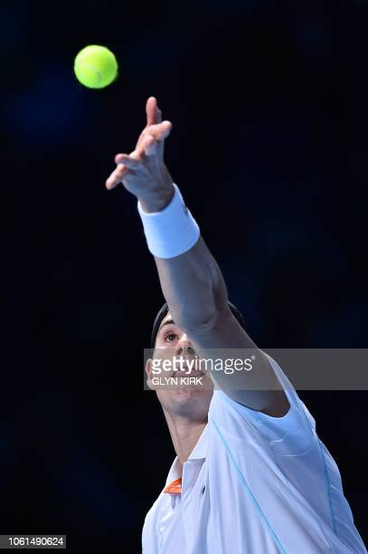 Player John Isner serves against Croatia's Marin Cilic during their men's singles round-robin match on day four of the ATP World Tour Finals tennis...