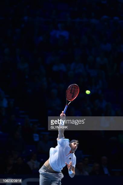 US player John Isner serves against Germany's Alexander Zverev in their men's singles roundrobin match on day six of the ATP World Tour Finals tennis...