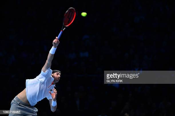 US player John Isner serves against Serbia's Novak Djokovic during their men's singles roundrobin match on day two of the ATP World Tour Finals...