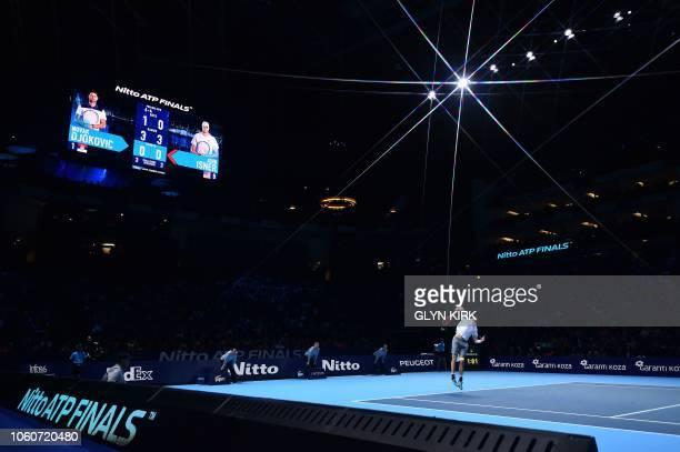 TOPSHOT US player John Isner serves against Serbia's Novak Djokovic during their men's singles roundrobin match on day two of the ATP World Tour...
