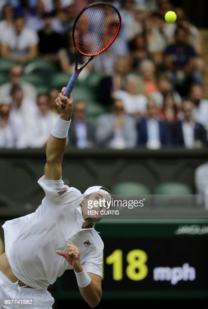 Player John Isner serves against South Africa's Kevin Anderson during their men's singles semi-final match on the eleventh day of the 2018 Wimbledon...