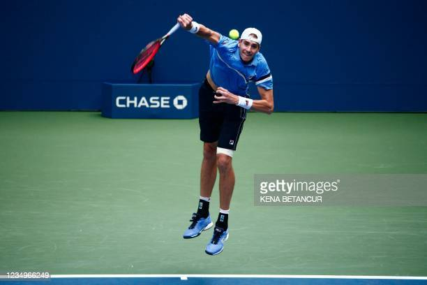 Player John Isner serves to US player Brandon Nakashima during their 2021 US Open Tennis tournament men's singles first round match at the USTA...