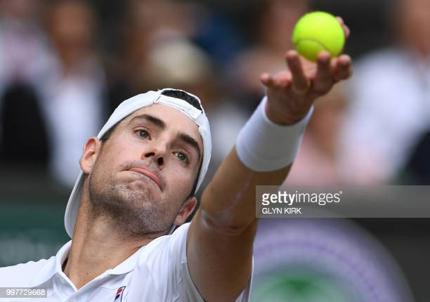 US player John Isner throws the ball to serve against South Africa's Kevin Anderson during their men's singles semifinal match on the eleventh day of...