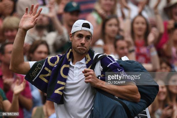 TOPSHOT US player John Isner waves to the crowd as he leaves the court after losing to South Africa's Kevin Anderson during the final set tiebreak of...