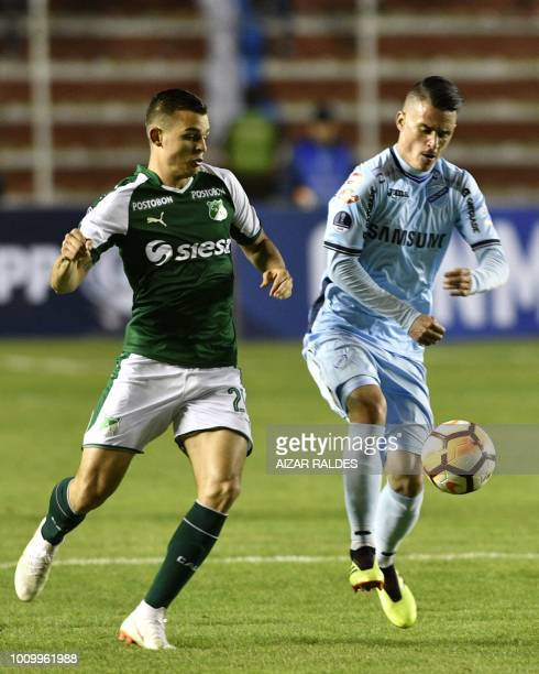 Player Juan Miguel Callejon of Bolivian Bolivar vies for the ball with Nicolas Benedetti of Deportivo Cali of Colombia during a Copa Sudamericana...